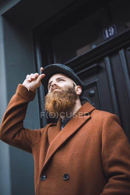 High angle view of thoughtful stylish bearded man looking up — Stock Photo