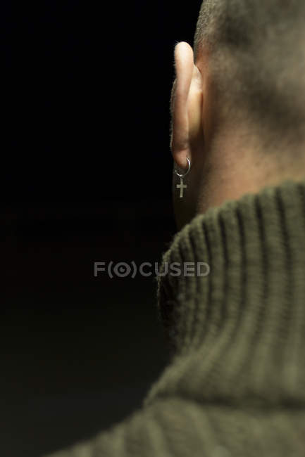 Crop rear view of male ear with earring — Stock Photo