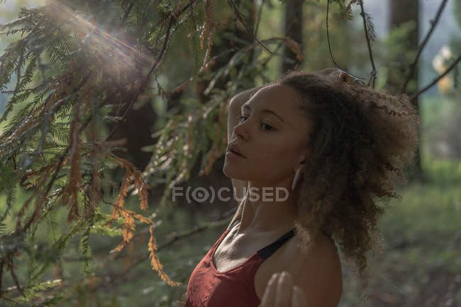 Sensual woman walking in forest — Stock Photo