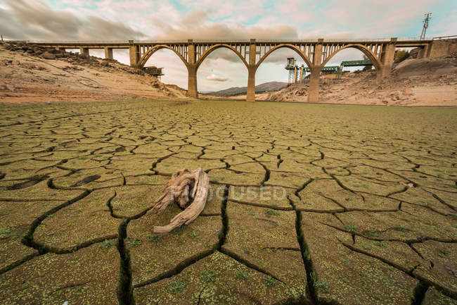 Surface level view of bridge over dry riverbed — Stock Photo