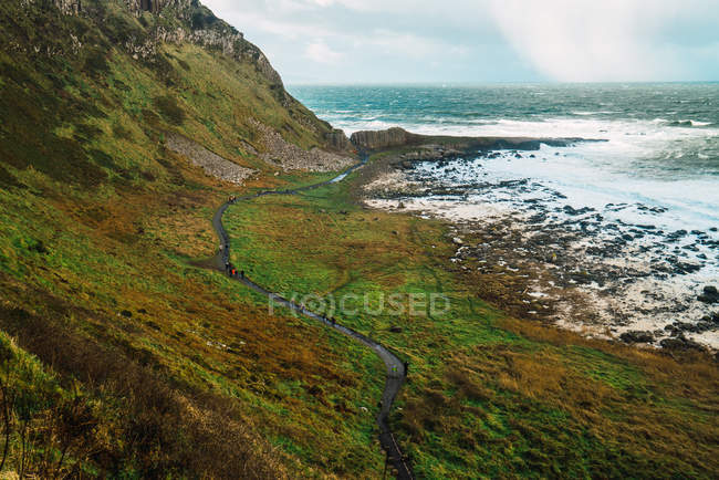 Low angle view to tight footpath on hill at seaside — Stock Photo