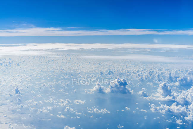 Aerial view to scenic bright bluew clouds — Stock Photo