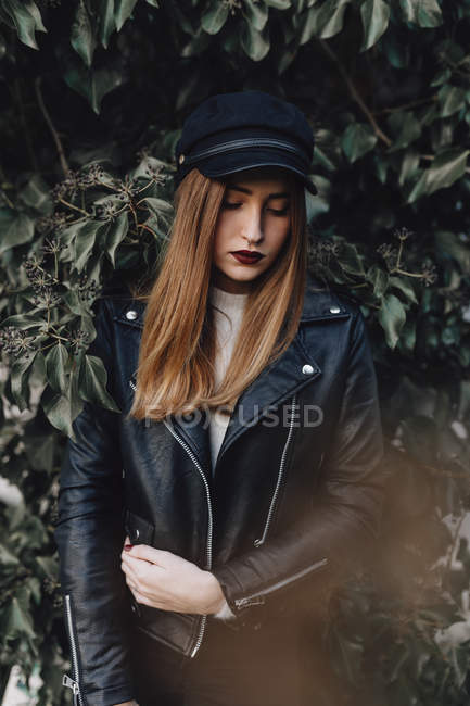 Trendy girl in black on green background — Stock Photo