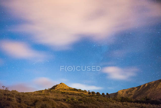 Scenic view of clouds over hills in evening — Stock Photo