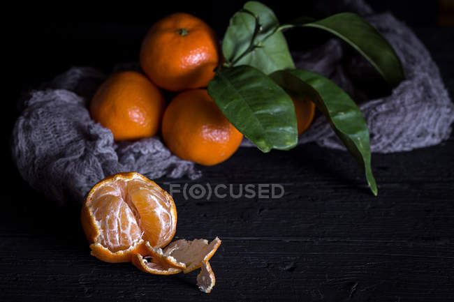 Still life of fresh tangerines on old rural table — Stock Photo