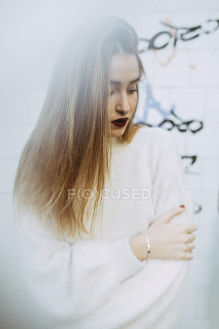 Dreamy girl in white posing in haze — Stock Photo