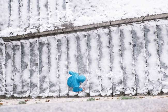 Directly above view of person climbing stairs with snow — Stock Photo