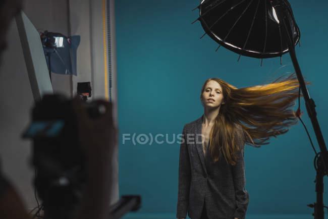Redhead woman posing at camera in studio — Stock Photo
