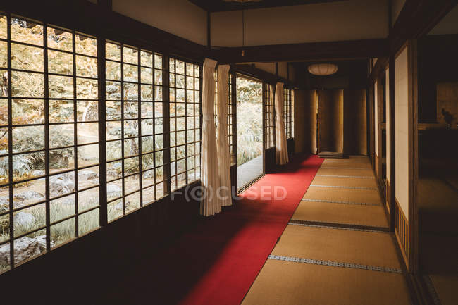 Minimalistic interior and light windows in traditional Asian house. — Stock Photo