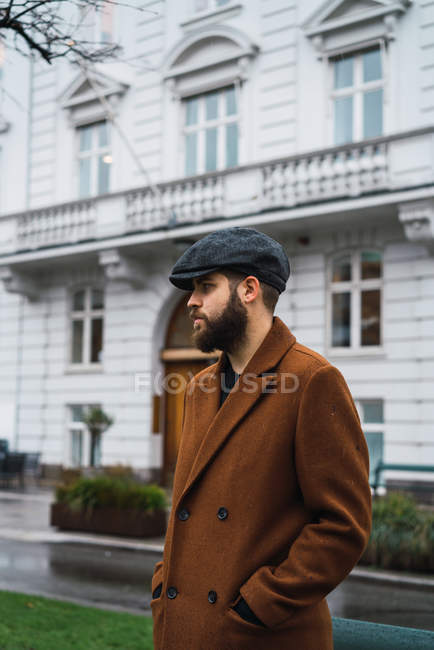 Portrait of bearded man wearing vintage clothes posing at street — Stock Photo