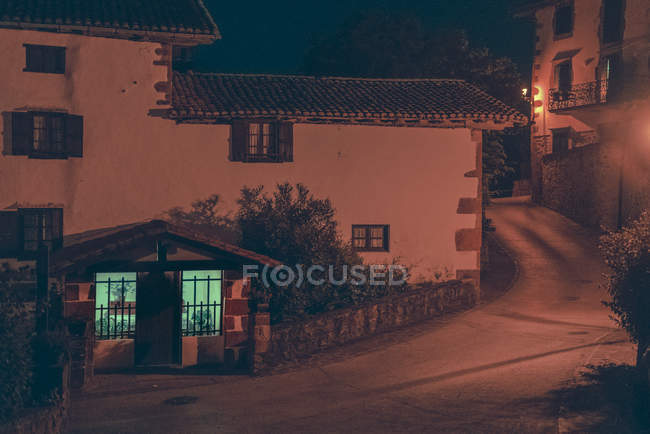 Exterior of cozy building with wooden entrance door at evening street scene — Stock Photo