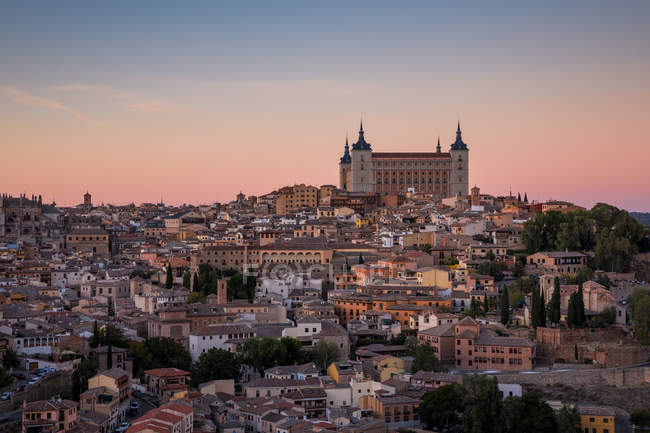 Aerial view over old town of Toledo at nightfall. — Stock Photo