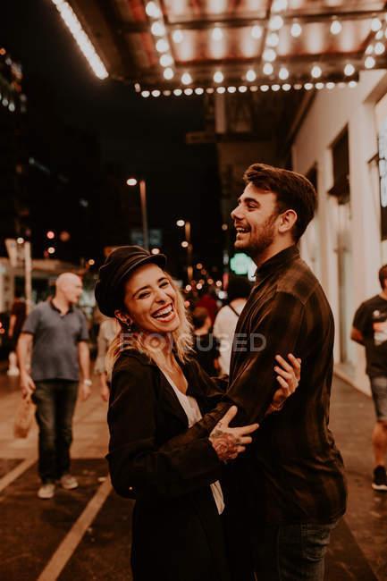 Romantic couple having fun on evening street — Stock Photo
