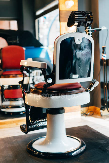 Empty chair in barbershop — Stock Photo