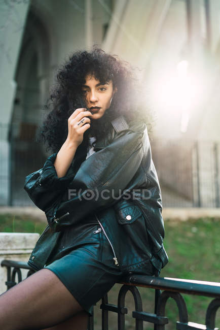 Curly woman posing railing — Stock Photo