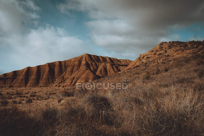 Prairie landscape with cliffs under dramatic sky — Stock Photo
