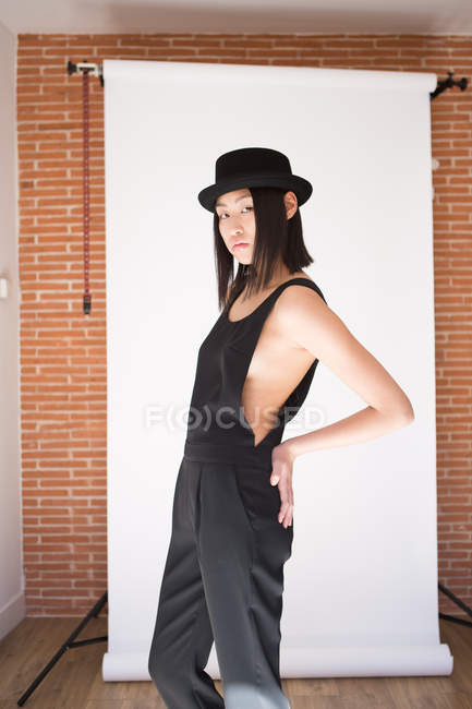 Stylish pretty woman posing in allover and hat — Stock Photo