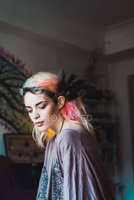 Sensual woman with pink hair looking down — Stock Photo