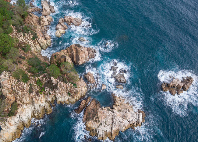 Aerial views of coastal rocks and surf in Mediterranean — Stock Photo