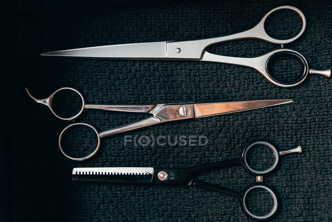 Set of various  professional barber scissors — Stock Photo
