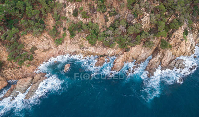 Aerial views of coastline with surfing waves of Mediterranean sea — Stock Photo