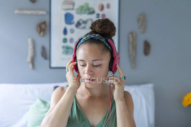 Charming girl listening to music with headphones — Stock Photo