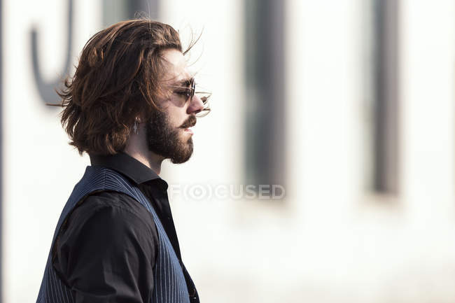 Side view of man in sunglasses posing on street — Stock Photo