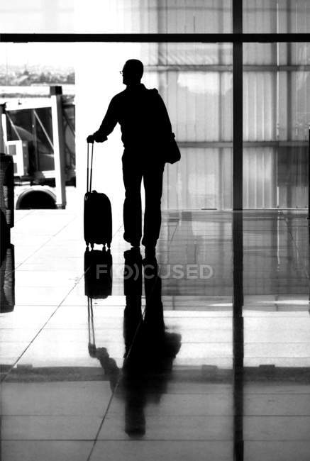 Tourist man standing with suitcase on station. — Stock Photo