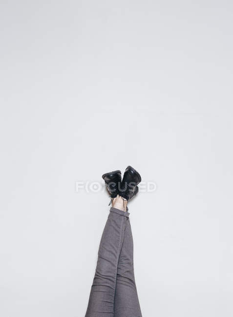 Crop legs in stylish boots at wall — Stock Photo