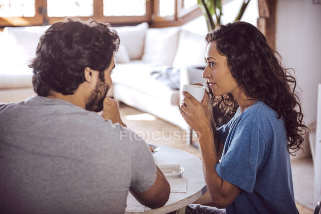 Young couple having breakfast together at home — Stock Photo