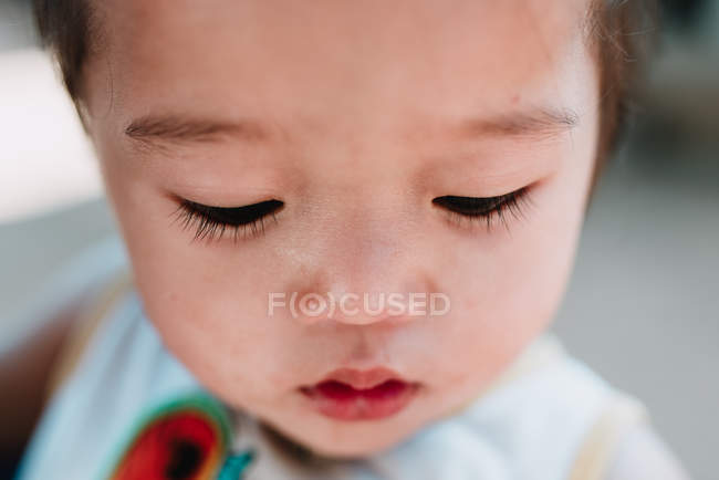 NONG KHIAW, LAOS: Portrait of boy looking down — Stock Photo