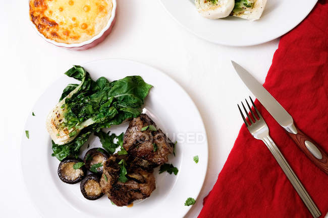 Directly above view of steak and vegetables garnish in plate — Stock Photo