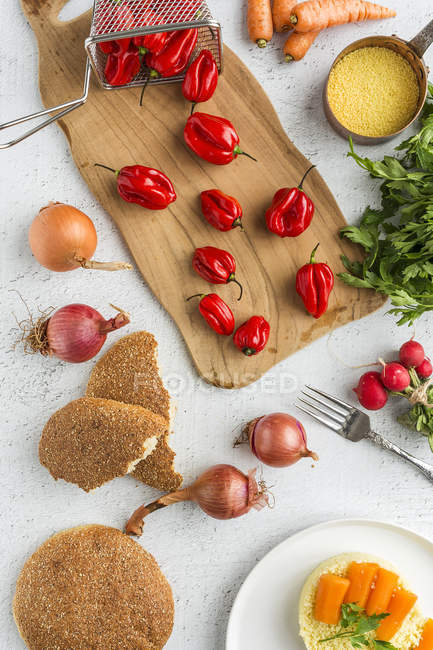Directly above view of fresh red peppers on table — Stock Photo