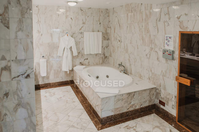 Interior of luxury bathroom with marble tiles — Stock Photo