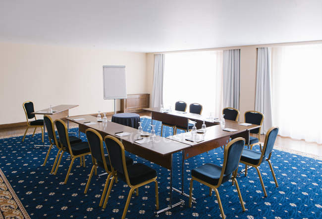 Interior of modern conference room with tables and whiteboard. — стокове фото