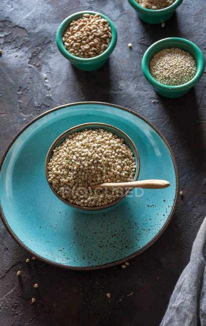 Bowl ceramic filled with buckwheat and various cereals wheat flakes. — Stock Photo
