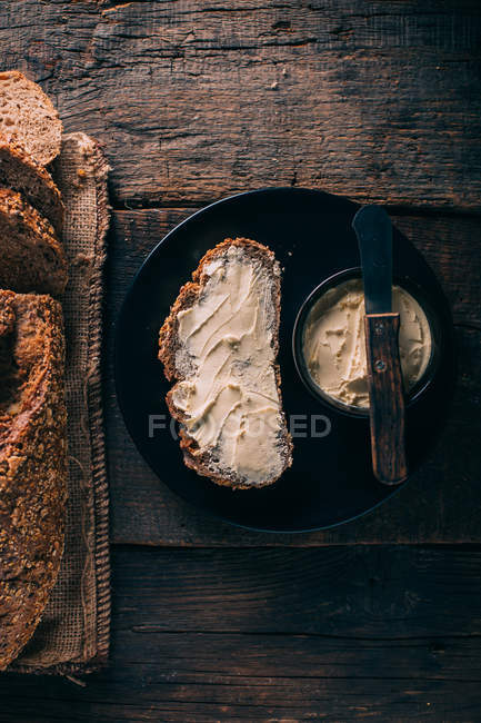 Directly above view of rustic bread with butter — Stock Photo