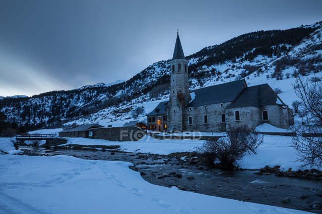 Exterior view of sanctuary building in mountain area at dusk — Stock Photo
