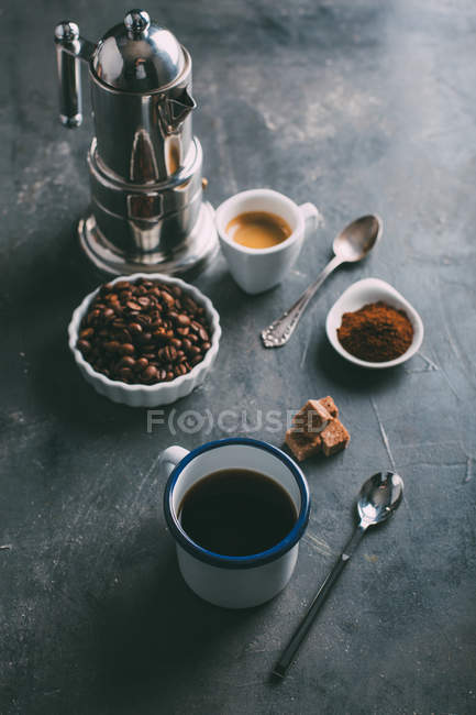 Still life of various coffee and ingredients on table — Stock Photo