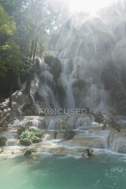 Scenic shot tropical waterfall in sunny day — Stock Photo