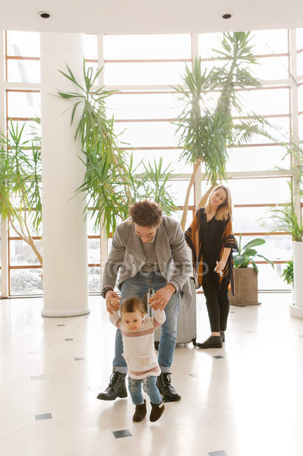 Young family with child in hotel hall — Stock Photo