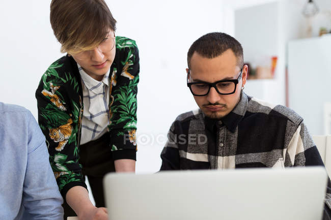 Man and woman coworking and brainstorming at laptop. — Stock Photo