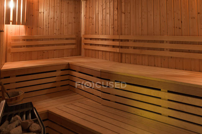 Interior view of wooden sauna with seats — Stock Photo