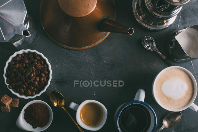 Different types of coffee and coffee makers on dark background — Stock Photo