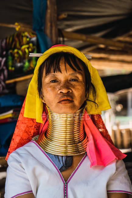 CHIANG RAI, THAILAND- FEBRUARY 12, 2018: Portrait of woman with golden rings on neck looking at camera. — Stock Photo