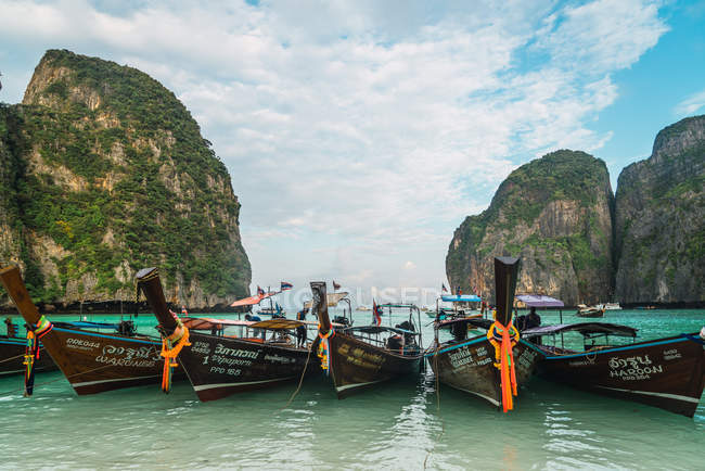 Rows of moored boats in turquoise water — Stock Photo