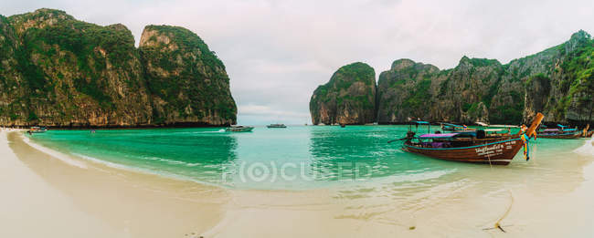 Panoramic view of sand beach with moored lagoon — Stock Photo