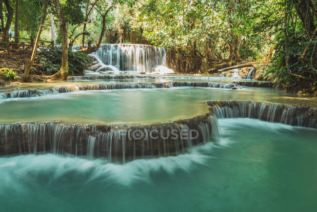 Scenic view to idyllic tropical waterfalls at jungle — Stock Photo