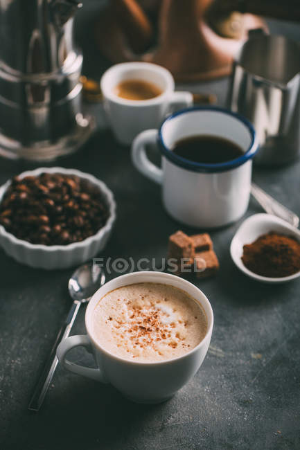 Different types of coffee and coffee makers on table — Stock Photo