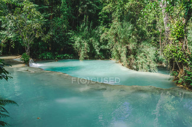 Scenic landscape of waterfall in tropical forest — Stock Photo